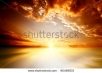 Stock Photo Red Sunset Over The Sea Rich In Dark Clouds Rays